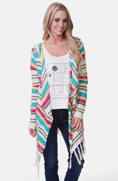This brightly striped poncho is a great way to infuse color into your fall wardrobe!  I wore it with grey skinny jeans, a grey v-neck, and over-the-knee camel boots!  LOVE!