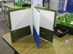 Make a four-pocket folder by combining a folder with brads with a plain two-pocket folder.