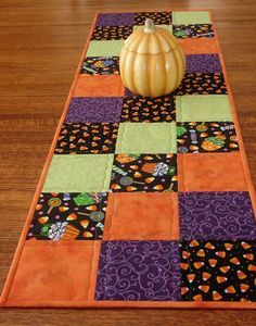 Quilted Halloween Table Runner  12-1/2 X 40    Add lots of bright and cheery fun to your Halloween decor with this quilted table runner. Bright orange