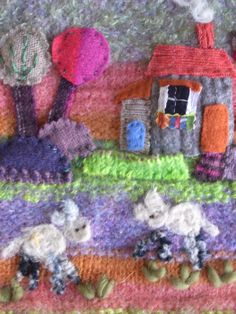 Collage made from a knitted and shrunken piece and decorated with pieces cut from old sweaters.