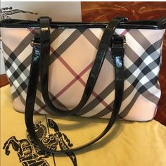 authentic Burberry handbag It's like new used only couple times comes with dust bag and authenticity card Burberry Bags Shoulder Bags