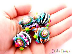 Funky zebra beads by Sigaliot on Etsy. I love the colors and patterns! Not sure what I'd make with them though... maybe put one on a keychain.