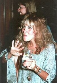 a cute photo of Stevie   ~ ☆♥❤♥☆ ~   with a mouthful of drink, waving Hi to the photographer at a function ~ love her pale blue outfit here ~ and her hair ~ and her nails ~ and her jewellery ~ and everything about her