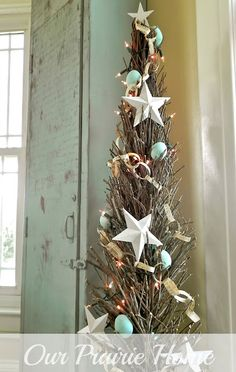 Perfect for small spaces,,,  trade out the Easter Eggs for Seashells, Pastel Hearts...  Love the Twig Tree!