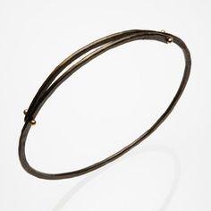 Peg Fetter: , Bangle bracelet in steel and 14k yellow gold.