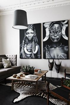 Faux zebra skin rug and beautiful African art in a living room @pattonmelo