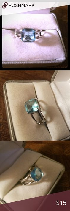 Size 7 Sterling Silver Blue Topaz Ring Please let me know what size you need. If I have it, I'll make you a separate post.    Sterling Silver stamped. Gorgeous 3 ct. Princess cut blue topaz ring. This one is a size 7.  Feel free to buy it.  December birthstone.    New, never worn.  Box in picture is for display purposes only.  Smoke free.  Free gift with purchase. Don't forget to bundle together to save an extra 15% off and to save on shipping too. =) Thank you kindly. Jewelry Rings