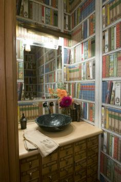 """From """"Good Things In Small Packages"""" comes this """"Literary Bathroom."""" -- I'm not crazy about this particular wallpaper, but I love the repurposed card catalog as sink cabinet..."""