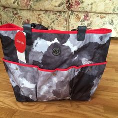 Lululemon Tote Lululemon Totally Totastic Tote II. Reversible with neoprene to repel sand on one side and polyester on other side. Beautiful bag with many uses. Use as gym bag, beach/pool bag or weekend bag. Beautiful Lululemon detailing throughout. NEW WITH TAG lululemon athletica Bags Totes