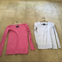 4 long sleeve light sweaters  America Eagle 4 long sleeve light sweaters all a size small one  has small hole as pictured and the rest a in great shape only worn a few times Tops Tees - Long Sleeve