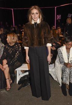Pin for Later: The Stars Continue to Catch Our Eye as Fashion Month Moves Along Olivia Palermo at NYFW It was wide-leg trousers and a furry brown jacket for Olivia as she attended Milly by Michelle Smith.