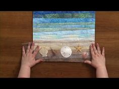 In this video, June Dudley makes a water landscape with small strips of fabric. She teaches you how to gather fabrics with a variety of strips to get what yo...