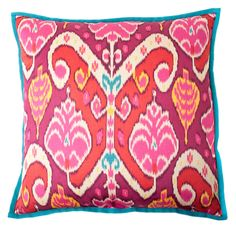 A lively abstract pattern in hues of bright pink and teal adorns this exhilarating cotton throw pillow. This California-made pillow is filled with 95-percent feather and 5-percent down for a perfectly plush accent to any decor.