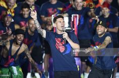 Barcelona's Argentinian forward Lionel Messi delivers a speech as he takes part in the celebrations held for their victory over Juventus, one day after the UEFA Champions League final football, at the Camp Nou stadium in Barcelona on June 7, 2015. Luis Suarez and Neymar scored second-half goals to give Barcelona a 3-1 Champions League final victory over Juventus on June 6, 2015 as the Spaniards became the first team to twice win the European treble. AFP PHOTO/ JOSEP LAGO