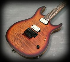 Kiesel Guitars Carvin Guitars DC600 deep orangburst over flamed maple top in a satin finish on black limba body, royal ebony fretboard