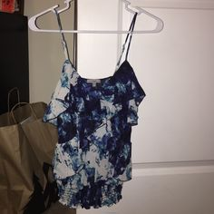 Ruffle tank top Charlotte Russe small ruffle tank top. Bottom is elastic and fits taut to your waist while the top is flowy and ruffled. Cute under a blazer for work or cute by itself for going out. Black/blue/white. Charlotte Russe Tops Tank Tops