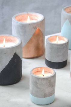 Stunning heavy concrete candles with copper / black and pastel accents. They all have wonderful scents , from fig and olive, to bergamot. The perfect home decor object and also great gift idea for candle lovers. #ad #concrete #candle #pastel #black #copper #homedecor #giftidea #scentedcandle