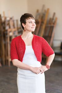 Noel Bolero - from Love of Knitting's Holiday Knits 2014 Issue  Knit from the bottom up in a fun, lacy stitch pattern, this shrug offers the perfect amount of coverage. Stitch one up in your favorite neutral color for a look you can wear every day, or choose a bright color to add a touch of drama to any outfit. The simple four-row pattern repeat is quickly memorized for easy knitting, and the rolled stockinette edging completes the design for an elegant yet playful garment.