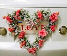 A old classic vintage car decorated with a heart shaped floral wreath. A old classic vintage car decorated with a heart shaped floral wreath. Free Wedding Catalogs, Wedding Cards, Wedding Day, Wedding Bells, Dream Wedding, Bridal Car, Wedding Car Decorations, Simple Weddings, Rustic Wedding