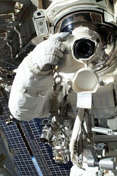 NASA astronaut Chris Cassidy, Expedition 36 flight engineer, uses a digital still camera during a session of extravehicular activity (EVA) as work continues on the International Space Station. A little more than one hour into the spacewalk on July 16, 2013, European Space Agency astronaut Luca Parmitano (out of frame) reported water floating behind his head inside his helmet. The water was not an immediate health hazard for Parmitano, but Mission Control decided to end the spacewalk early.