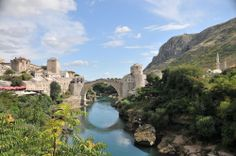 City of Mostar and beautiful stone bridge on Neretva in BiH Packing Tips For Travel, Travel Advice, Amazing Destinations, Travel Destinations, Offshore Bank, Serbia Travel, Top Site, Fun Walk, Best Cities