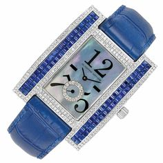 Lady's White Gold, Mother-of-Pearl, Diamond and Sapphire Wristwatch, Guiseppe Artore 18 kt., quartz movement, centering an oversized rectangular mother-of-pearl dial with blue and pink hues, with a diamond-set subsidiary seconds dial, flanked by elongated rectangular panels centering a double row of invisibly-set square-cut sapphires, edged by small round diamonds, water resistant, diameter approximately 42 x 33 mm., completed by a blue leather strap and white gold diamond-set buckle