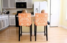 he bought two Ikea counter stools and one of the $20.00 slipcovers they make for that style of stool. Then she promptly took the slipcover apart to use as a pattern and made her own slipcovers out of orange and white oilcloth. Dang! I wish I would have thought of that.