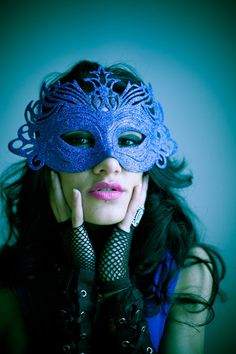 Blue Mask. I love the layered gloves with leather and fishnet.