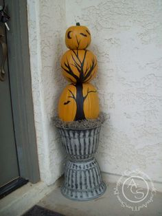 Halloween Pumpkin Topiary Outdoor Decor - Foam pumpkins glued together into a tower.  Tree is black vinyl contact paper adhered in sections to each pumpkin.  Cute and easy to do.  Just need a template for a tree and I have lots of those.  I think I would do a mixed group of three topiary with two being the pumpkin tree and the third being a life size skeleton torso - creepy!