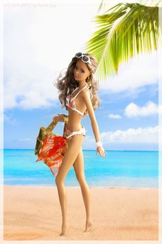 Beauty and the beach. In this photo: Miss Aquamarine™ Barbie® doll.