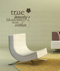 True beauty blossoms from within, like design and words, over bathroom mirror