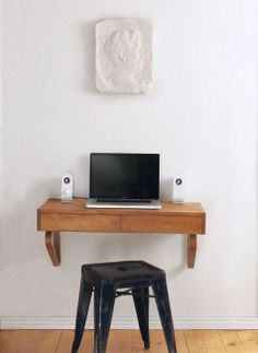 Even if you don't have room for an office or a full size desk, you might have room for a shelf to hold your laptop!