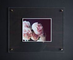 This kit includes everything you need to hang your favorite print    Two 16x20 acrylic panels with predrilled holes  Four small brass bolts