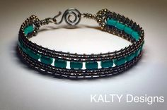 Wire weave oxidised copper with turquoise bead. Design from KALTY Designs.