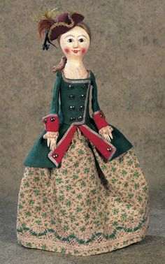 cute colonial-style doll in her riding habit