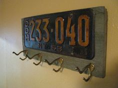 Vintage coat rack made with a real vintage license plate-Fathers Day-barnwood- and vintage brass hooks- NEW YORK. $59.00, via Etsy.