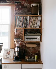 warpten:  ironworthstriking:  resolutewoman:  favorite corner.  I want everything in this photo. Specifically the grinder, the radio, the turntable, the records, the wall, the window, and the counter top. Not too much to ask right? related. does anyone know what grinder that is?  It's a Mazzer Robur E grinder.