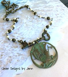 FUF 8/28 .. A B'sue Ship Component dangles beneath a old skeleton key that is wire wrapped .. both the key and ship are colored using Swellegant and Perfect Pearls .. A beautiful chain made with metal beads, pearls and chain complete this beauty .. Clever Designs by Jann   https://www.etsy.com/shop/CleverDesignsbyJann