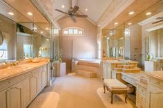 His and her bathroom with vanity seating.