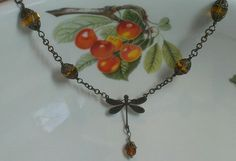 Necklace made with Vintaj dragonfly connector, antique brass findings, and honey-colored Czech glass beads.