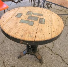 metal patches...wooden table- LOVE THIS!
