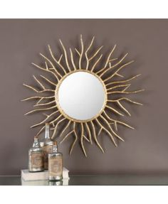 With a nod to mid-century modern design, the Uttermost Astor Gold Starburst Wall Mirror is sure to become a showstopper in your modern home.