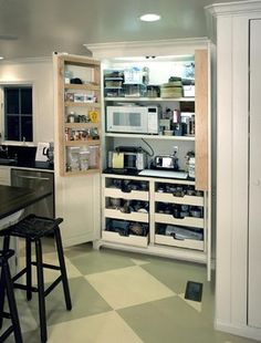 *large/tightly packed appliance cabinet w/deep shelves & pull-out drawers, electric sockets for toaster, blender, convection oven, microwave, crockpot, bread machine, dehydrator, seal-a-meal, electric knife, mixer, mix master, rice cooker, magic bullet, ...