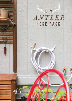 diy antler hose rack from GoingHomeToRoost...... talk about a conversation piece when you have a little garden party. (they're affordable faux antlers!)