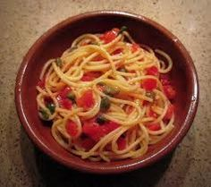 """Pasta alla Carrettiera - """"cart driver's   pasta"""" because they only one pot. Uncooked sauce """"cooks"""" in heat of boiled pasta. 1 small bunch mint leaves (about 1 c leaves) 2-3 medium garlic cloves, 4 plum tomatoes 2 TB olive oil; Salt & freshly grnd pepper; 1 lb pasta; grated pecorino cheese. Mash mint  leaves & garlic with mortar & pestle. Quarter tomatoes, mash with  mint & garlic. Add olive oil, salt & pepper. Cook pasta, drain   well, add sauce, mix well. Sprinkle   cheese on top."""
