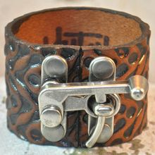 Embossed Tread Pattern Leather KLUTCH Band by RockCandy Leatherworks, in our Visitor Center gift shop now!