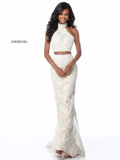 f9439499c18 Sherri Hill 51770 is a two piece lace halter prom gown with choker collar  and a tie back.