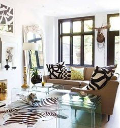 Home Design and Decor , Decorating With Fashionable Zebra Rug : Living Room With Glass Coffee And Nesting Tables And Mirror And Zebra Rug