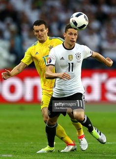 #EURO2016 Julian Draxler of Germany controls the ball under pressure of Artem Fedetskiy of Ukraine during the UEFA EURO 2016 Group C match between Germany and Ukraine at Stade Pierre-Mauroy on June 12, 2016 in Lille, France.