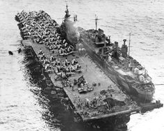 "On this day in history:  Photo of the Essex-class carrier USS Randolph with damage to her flight deck as the result of a Japanese Yokosuka P1Y Ginga ""Frances""kamikaze attack crashing into her at Ulithi Atoll two days earlier. 13 March 1945."